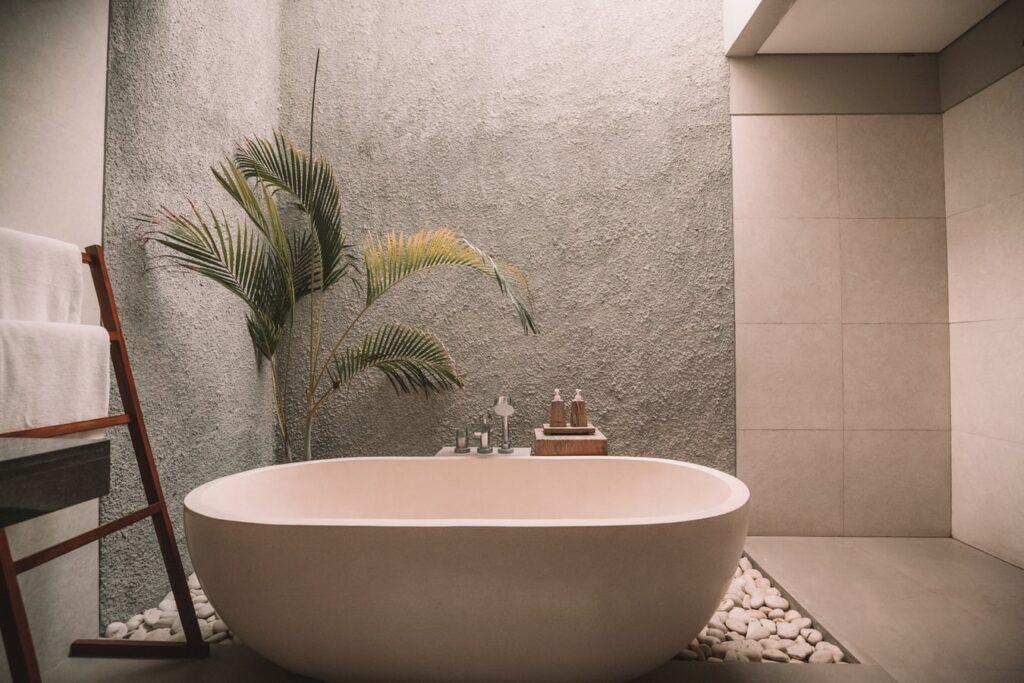 bathroom remodel with bathtub and plant
